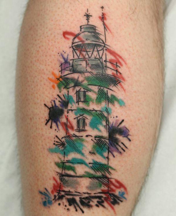 Aquarell Leuchtturm Tattoo am Unterschenkel