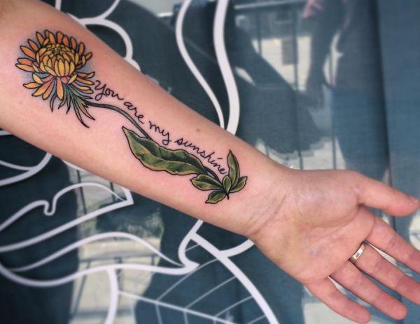 Löwenzahn Tattoo Sprüche Englisch am Unterarm