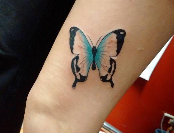 Schmetterling Design am Oberschenkel