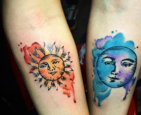 Wasserfarben Sonne und Mond Desgin am Unterarm