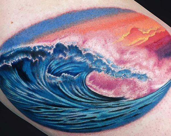 Wellen Abendrot Tattoo auf der Bein